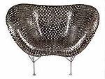 Кресло, изготовленное из настоящих монет