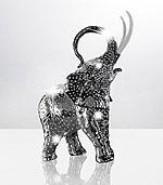 Фарфоровый слоник, покрытый платиной, принесет счастье